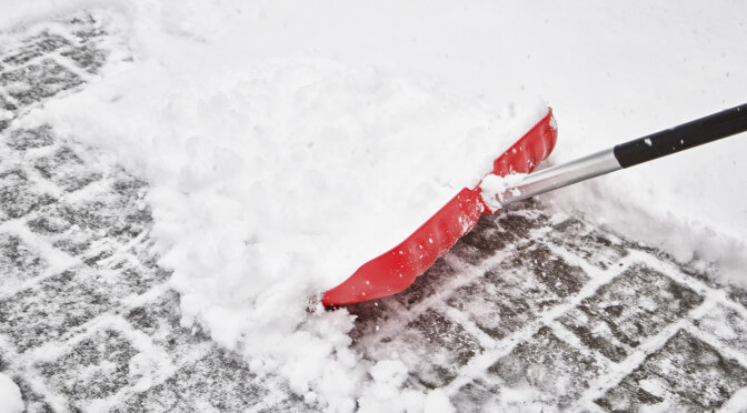 Red blurry snow shovel